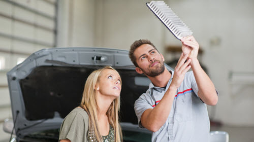 Car Owner and Mechanic Checking Air Filter