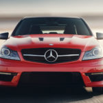 Red Mercedes-Benz on Road